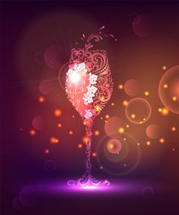 A glass of wine from lace and grapes with sparks