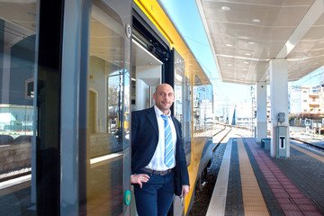 The train conductor in the door of the train
