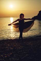 Little Girl In A Sea Sunset