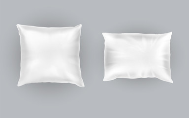 Vector realistic set of two white pillows, square and rectangular, soft and clean, top view isolated on gray background. Object for sweet dreams in bedroom, mockup with blank cushions for your design