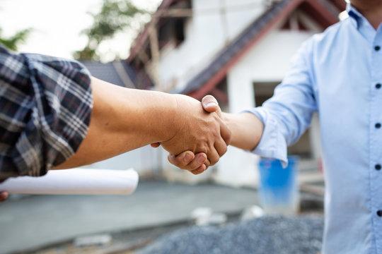 Shaking hands of partnership agreement engineer.