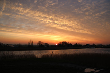 Sunrise over river Hollandse IJssel with colorful sky in the Netherlands