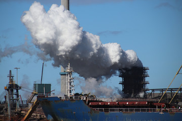 White steam from steelworks at the steel factory in Ijmuiden, the Netherlands