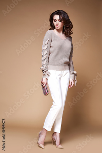 471772fe8 Sexy beauty woman pretty face young wear white pants beige sweater ...