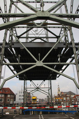 vertical lift bridge in special angle over the river Gouwe in Waddinxveen in the Netherlands