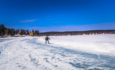 Falun - March 30, 2018: A newbie ice skater at the resort of Framby Udde near the town of Falun in Dalarna, Sweden