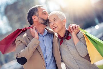 Mature couple enjoying shopping together
