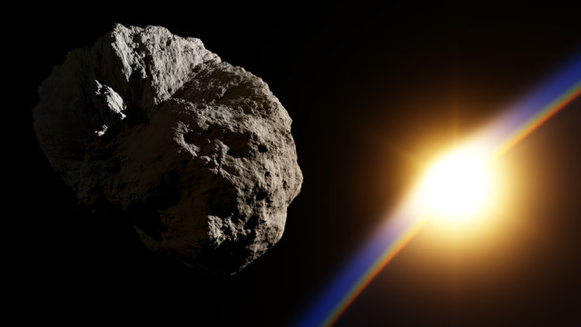 Huge asteroid in space approaching planet with sunrise
