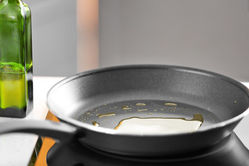 Frying pan with cooking oil on stove