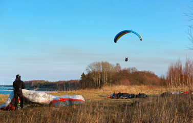 to fly on a paraglider, to be engaged in sports on a motor paraglider, paragliders are fond of flights