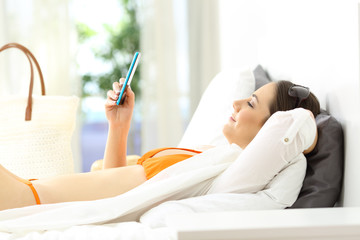 Woman using a smart phone in an hotel in summer vacations