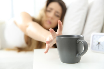 Woman waking up needing coffee