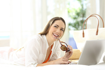Woman with a laptop thinking on vacations