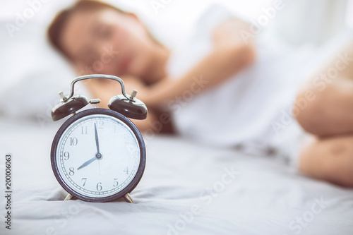 Beautiful Asian Young Woman Turn Off Alarm Clock In Good Morning Wake Up For Sleep With Closeup Foreground Alarm Clock Relax And Lifestyle Concept