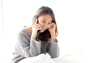 Young asian woman talking phone on white background, people lifestyle