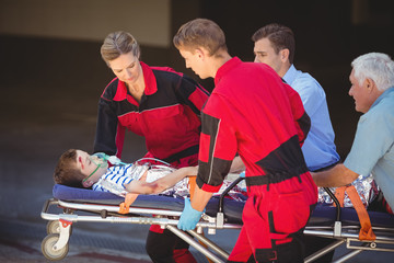 Paramedics rushing a patient in emergency