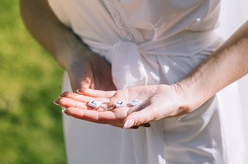 Hands of bride with cubes with the text of love