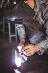 Welder working on a piece of metal