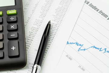 Stock exchange price index, budget, economics or investment concept, pen on price numbers report, graph and chart print paper with calculator on table
