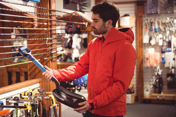 Man selecting shovel in a shop