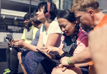 Wall Mural - Group of diverse people using digital devices
