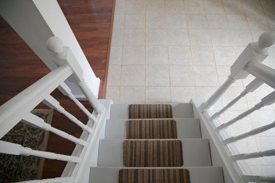 Looking down stair cast to tile floor