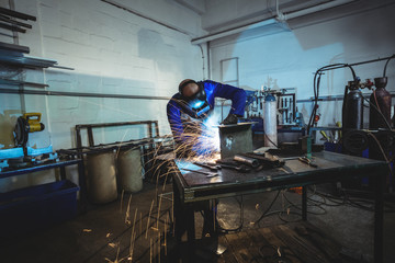 Male welder working on a piece of metal