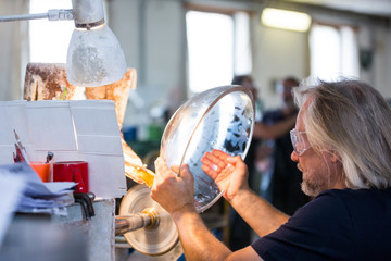 Glassblower working on a glass