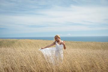 Blonde woman standing in field