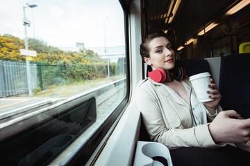 Portrait of woman traveling in train
