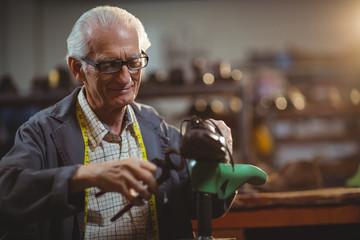 Shoemaker repairing a shoe
