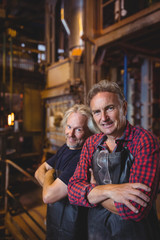Portrait of glassblowers with arms crossed