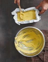 Fototapete - Healthy food Man preparing corn bread top view