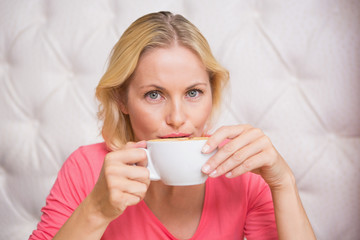 Pretty blonde having coffee