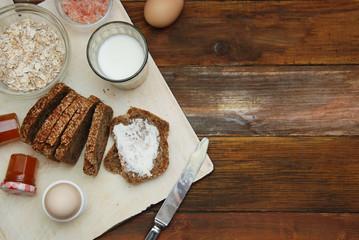 Healthy Breakfast. Fitness food. Eggs, Bread, Butter, Milk. Wooden Background. Flat Lay.
