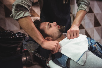 Barber putting towel over clients neck