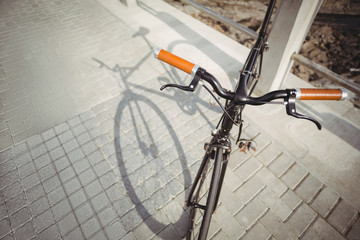 Bicycle leaning by promenade railing