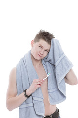 young man with towel and toothbrush.isolated on white