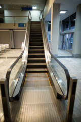 Escalator next to waiting area