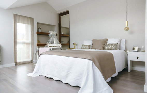 Sober and elegant bedroom with double bed and cot with canopy