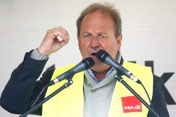 German public sector workers union Verdi leader Bsirske delivers a speech during the strike at the airport in demand for higher wages in Frankfurt