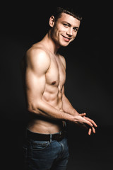 Portrait of beaming male stripped to waist while slapping hands. Gladness concept