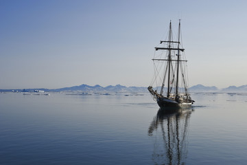 sailing ship in arctic sea with copy space