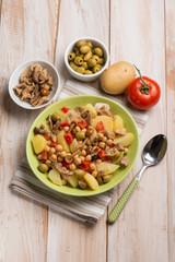salad with chickpeas potatoes tomatoes mushroom and olives