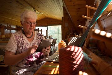 Senior woman using digital tablet at shop
