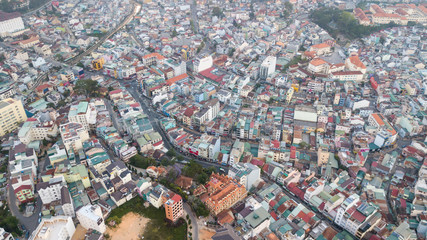 Aerial view from the drone to Dalat city roofs and roads.Located on the Langbian Plateau in the southern parts of the Central Highlands region of Vietnam