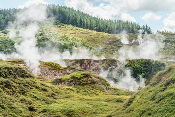 Geothermal hot springs on sunny day, Craters of the Moon, New Zealand
