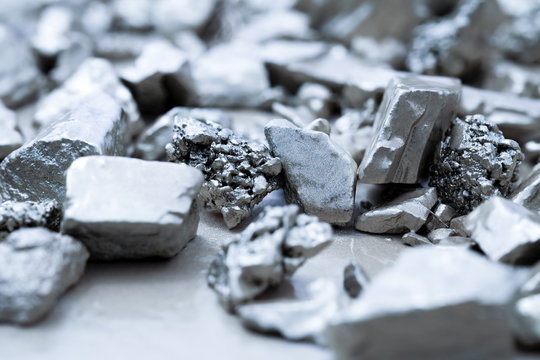 lump of silver or platinum on a stone floor