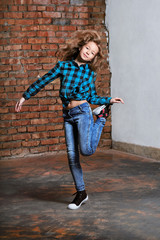 Girl teenager,loft indoors,brick wall,full growth. Youthful fashion,urban style.Young hipster woman in blue shirt in cage.Beautiful person female adolescent advertising modern,casual,street lifestyle.