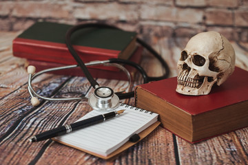 skull with old text book ,concept with medical education .